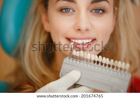 Dentist curing female patient, Woman having teeth examined at dentists. Teeth care and tooth health.  selective focus. - stock photo