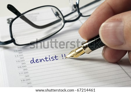 dentist date in business organizer and  time planer - stock photo
