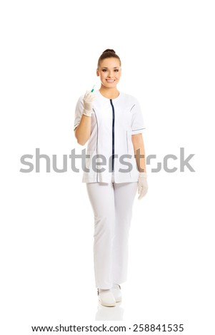 Dentist doctor holding a syringe - stock photo