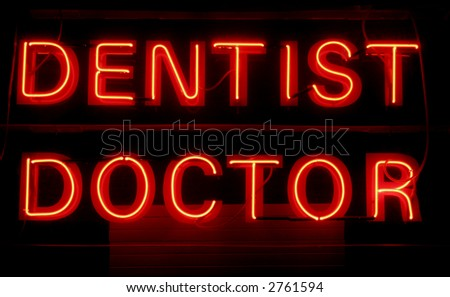 Dentist Doctor - Red Neon Light Advertising On A Black Background