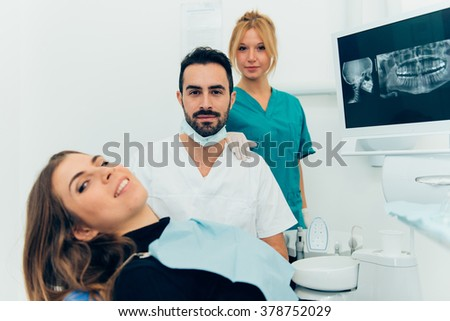 dentist doctor with the assistant in the clinic - stock photo