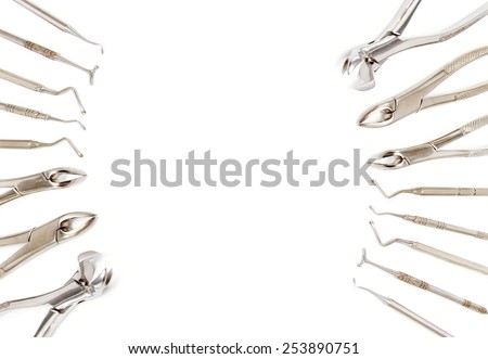 Dentist extraction forceps and dental equipment, Dental equipment background - stock photo