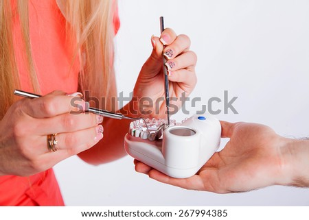 Dentist holding dental jaw model with sutures, dental implants - stock photo