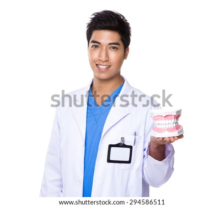 Dentist holding with denture - stock photo
