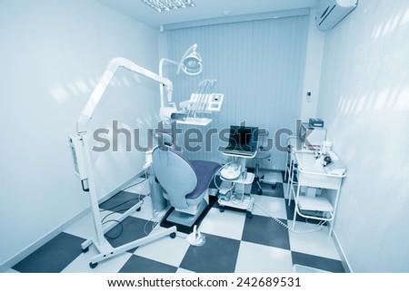 Dentist office. Blue tone. - stock photo