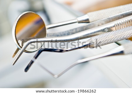 dentist's instruments with shallow depth of field - stock photo