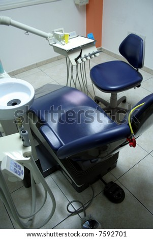 Dentist's space of work with chair, sink, etc - stock photo