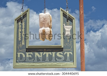 Dentist Sign Against A Blue Sky Background - stock photo