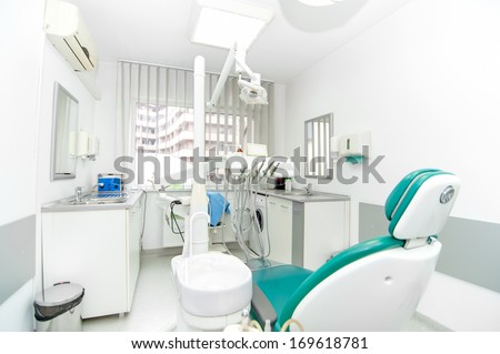 Dentist tools and professional dentistry chair waiting to be used by orthodontist  - stock photo