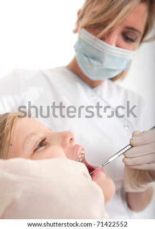 Dentist treating a child