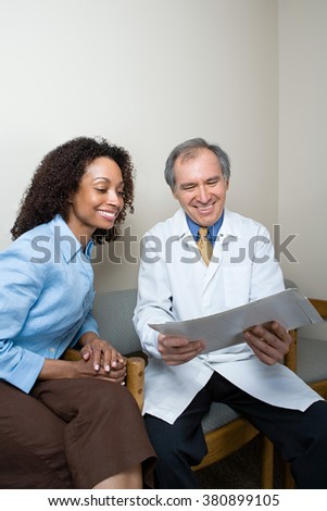 Dentist with patient - stock photo