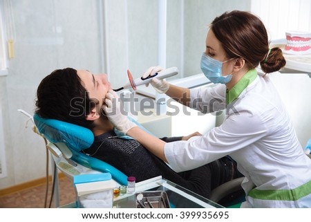 Dentist woman doing the procedure in the dental office