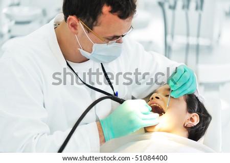 Dentist working - stock photo