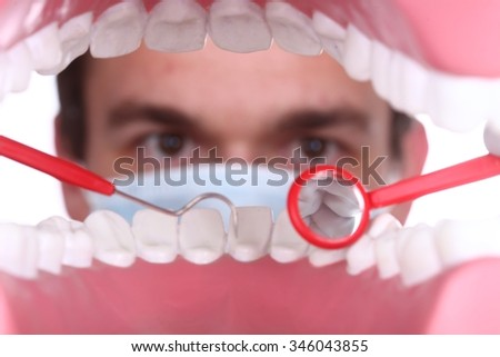 Dentist Working Inside a Patient Mouth - stock photo