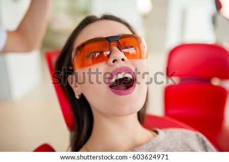 Dentistry, open mouth at the beautiful brunette girl.