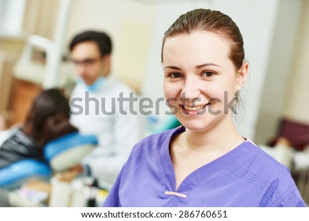 dentistry. Portrait of female dentist woman in uniform in dental clinic - stock photo