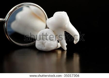 Dentistry. Wisdom teeth and dental instruments - stock photo