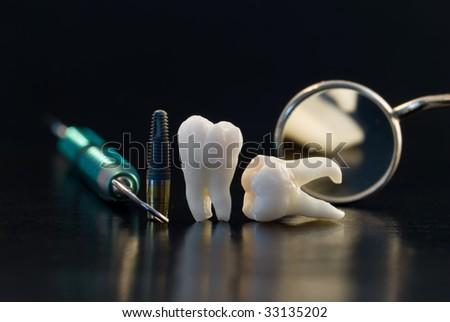 Dentistry. Wisdom teeth, implant and dental tools - stock photo