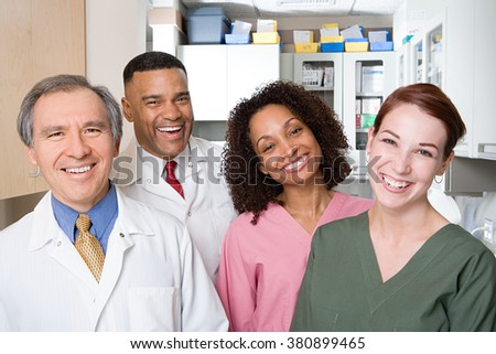 Dentists and dental nurses - stock photo