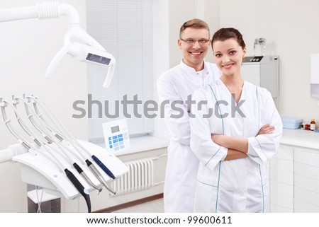Dentists in the form at the clinic - stock photo