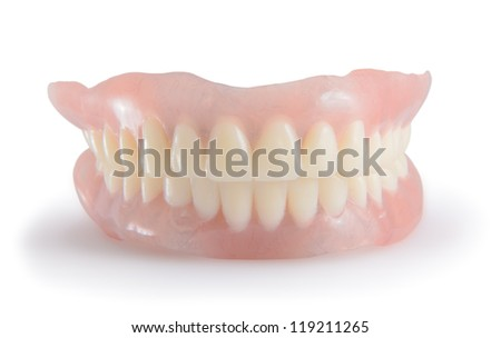 Dentures isolated on a white background. - stock photo