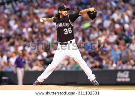 DENVER-AUG 21: Colorado Rockies pitcher Christian Bergman pitches during a game against the New York Mets at Coors Field on August 21, 2015 in Denver, Colorado. - stock photo