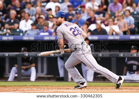 DENVER-AUG 21: New York Mets infielder Daniel Murphy swings at a pitch during a game against the Colorado Rockies at Coors Field on August 21, 2015 in Denver, Colorado. - stock photo