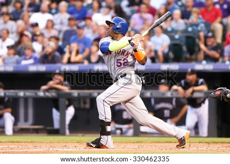 DENVER-AUG 21: New York Mets outfielder Yoenis Cespedes swings a pitch during a game against the Colorado Rockies at Coors Field on August 21, 2015 in Denver, Colorado. - stock photo