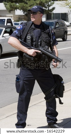 DENVER - AUGUST 25: A riot police officer stands guard during the Democratic National Convention August 25, 2008 in Denver. - stock photo