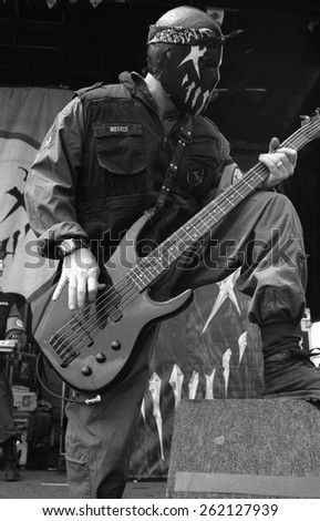 DENVERAUGUST 22:Bassist Pig Benis of band Mushroomhead performs in concert August 22, 2002 at the Pepsi Center in Denver, CO.  - stock photo
