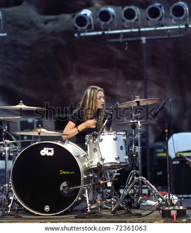 DENVER - AUGUST 28:Drummer Martina Axen of the all female Heavy Metal band Drain STH performs in concert August 28, 1998 at Red Rocks Amphitheater in Denver, CO. - stock photo