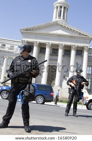 DENVER - AUGUST 26: Police officers stand in front of the Denver City and County Building during the Democratic National Convention August 26, 2008 in Denver. - stock photo