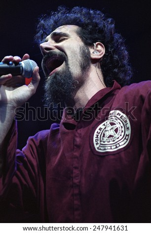 DENVER	AUGUST 22:		Vocalist Serj Tankian of the Heavy Metal band System of a Down performs in concert August 22, 2002 at the Pepsi Center in Denver, CO.  - stock photo