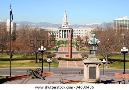 Denver City hall (City and County Building) viewed from Colorado State Capital, Civil War memorial in foreground, Spring. - stock photo