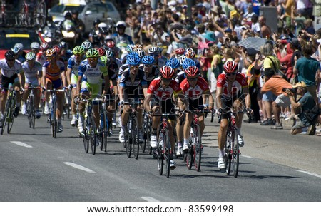 DENVER, CO - AUG 28: Thousands of spectators are cheering on the cyclists in the streets of Denver at the 2011 USA Pro Cycling Challenge in Denver, Colorado on Aug 28, 2011 - stock photo