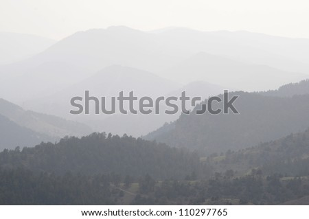 DENVER, CO - AUGUST 2012 - Smoke from 58 wildfires in neighboring states pollutes Colorado Rocky Mountains just west of Denver - stock photo
