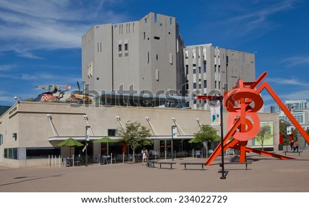 DENVER, CO - SEPTEMBER 17, 2014: Sculpture plaza in front of the Denver Art Museum in Denver, CO on 17 September 2014 with Architect Gio Ponti's original museum towers in the background. - stock photo
