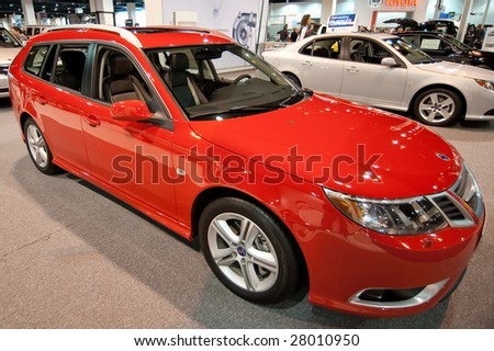 DENVER, COLORADO- APRIL 5: The SAAB is featured at the Denver Auto Show April 5, 2009 in Denver, CO. More than 20 car manufacturers worldwide display their latest models here. - stock photo