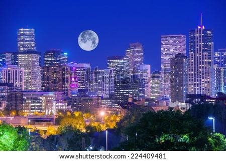 Denver Colorado at Night. Denver Downtown Skyline and the Full Moon on Clear Sky.  - stock photo
