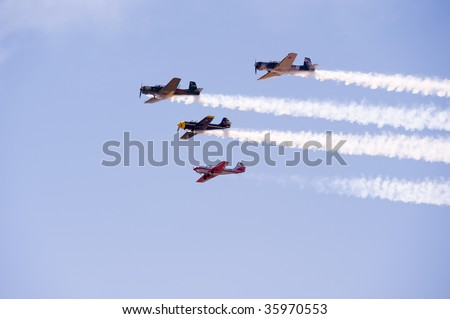 DENVER, COLORADO - AUGUST 22: Stunt planes fly in formation with smoke trails at the Jefferson County Airport air show on August 22, 2009 in Denver Colorado.