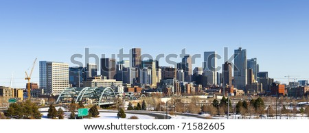 Denver Colorado city skyline from west side of town. Snow covered ground winter. - stock photo