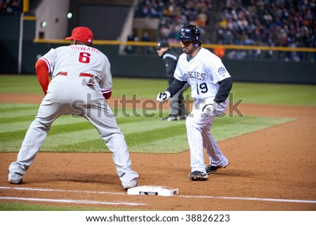 DENVER, COLORADO - OCTOBER 11:  Ryan Howard holds Todd Helton close to the first base bag in game 3 of the Rockies, Phillies National League Division Series on October 11, 2009 in Denver Colorado.