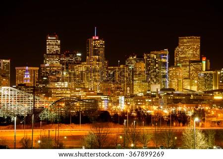 Denver, Colorado, USA - December 09, 2015: A panoramic night view of colorful December skyline of southwest-side Downtown Denver. - stock photo
