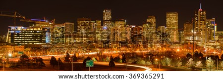 Denver, Colorado, USA - December 09, 2015: A panoramic night view of towering skyscrapers and busy streets at west-side of Downtown Denver.  - stock photo