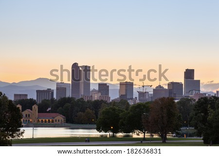 Denver downtown skyline and rocky mountain at sunset - stock photo