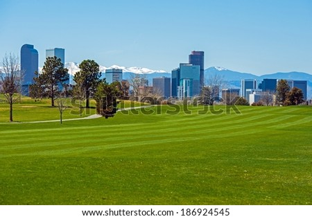 Denver Green Fields, Denver Downtown Skyline and Rocky Mountains Under the Snow. Colorado, United States. - stock photo