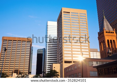 Denver in the morning with the rising sun reflecting in the building - stock photo