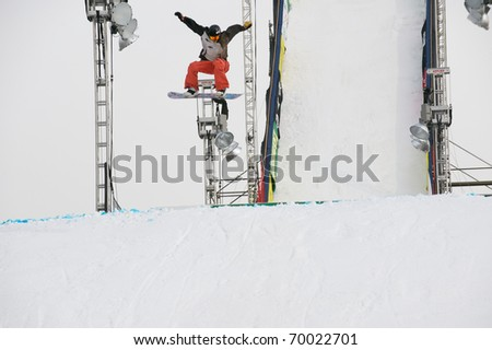 DENVER - JANUARY 26: An unidentified participant takes a practice run at the LG FIS World Cup Snowboard Big Air competition January 26, 2011 in Denver, CO.