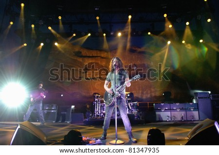 DENVER - JULY 18:Vocalist/Guitarist Chris Cornell of the Heavy Metal band Soundgarden performs in concert July 18, 2011 at Red Rocks Amphitheater in Denver, CO. - stock photo
