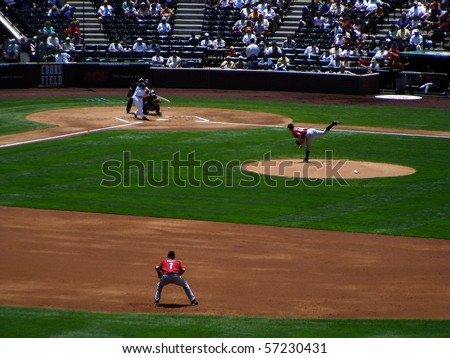 DENVER - JUNE 29: Aaron Miles of the Colorado Rockies connects on a pitch from pither Roy Oswalt of the Houston Astros in a game at Coors Field June 29, 2005 in Denver, Colorado - stock photo
